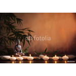 Buddha with burning candle and bamboo 64238