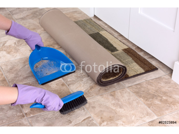 Image with a rolled rug and broom with dustpan 64238