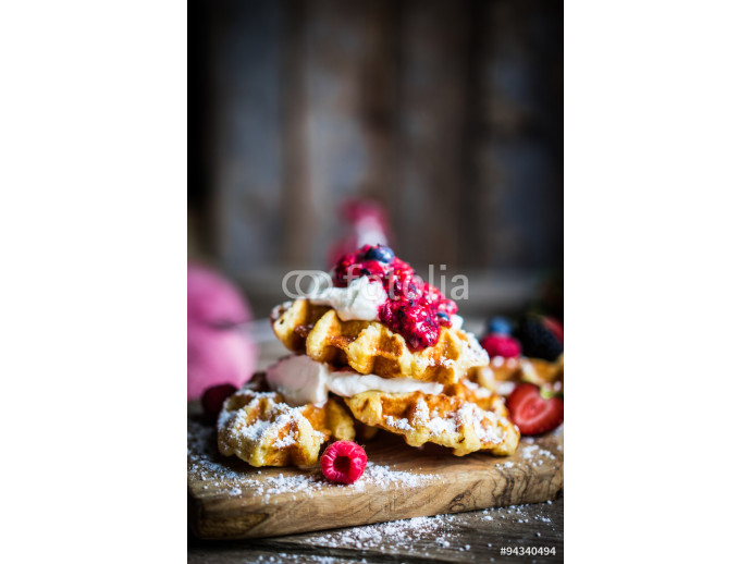Belgian waffles with fresh berries on rustic wooden background 64238