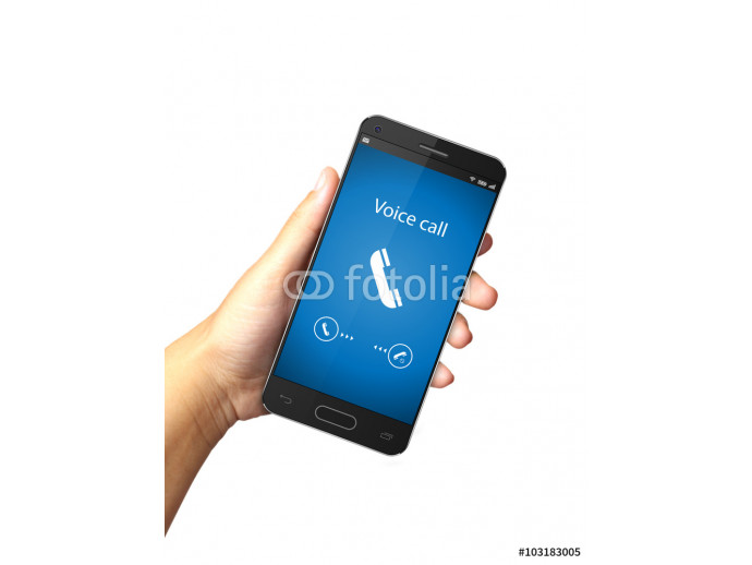 Hand holding smart phone with incoming call on display 64238