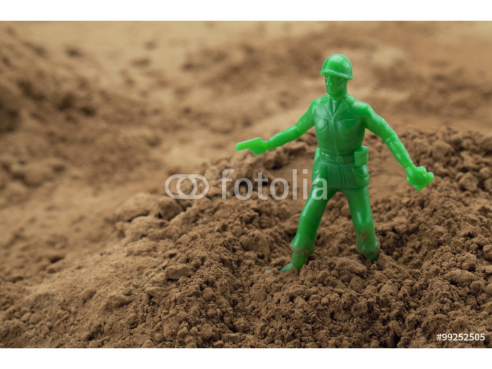 toy green soldier on sand 64238