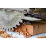 close up of circular saw and saw dust 64238