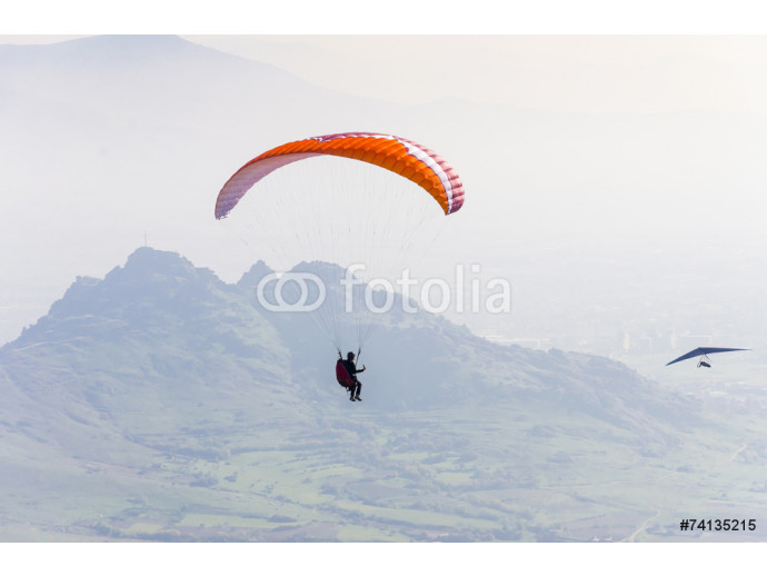 Paraglider flying smoothly through the air 64238