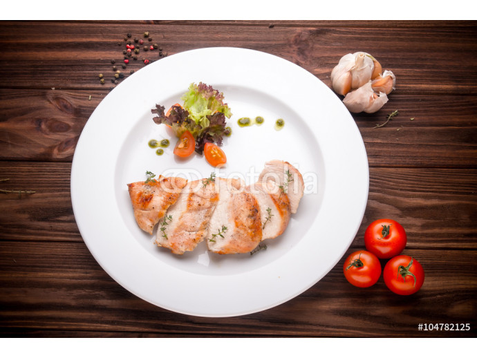 Stewed chicken fillet with vegetables and seasoning on a wooden 64238