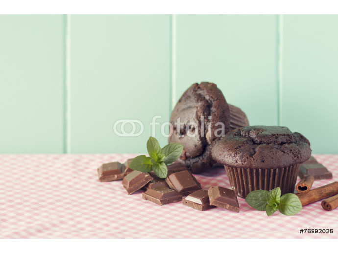 Chocolate muffins and chocolate pieces. Turquoise. Vintage look. 64238