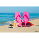 The sea, beach, sand and women's accessories: pink flip-flops, red sunglasses and starfish 64238
