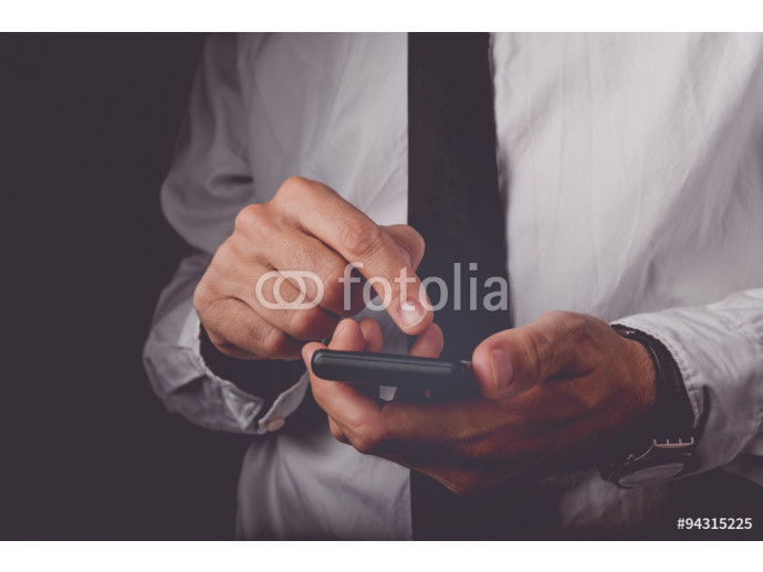 Businessman working on mobile smart phone 64238