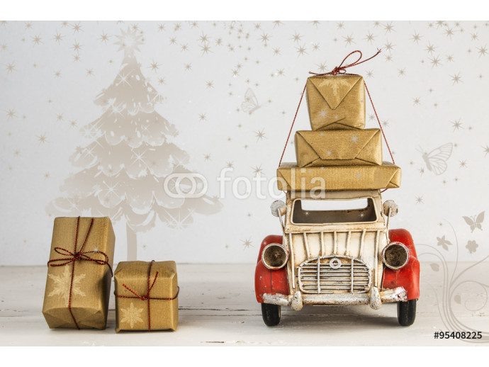 Christmas holiday concept with gift boxes on toy car 64238