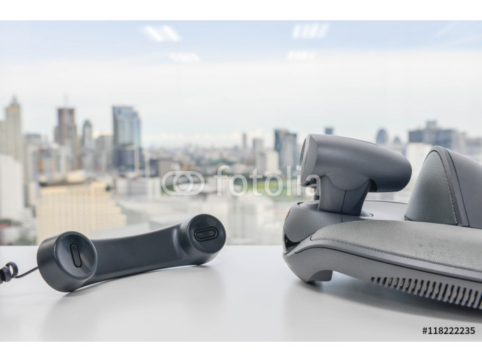 Video Conference Device and Phone handset on the white table 64238