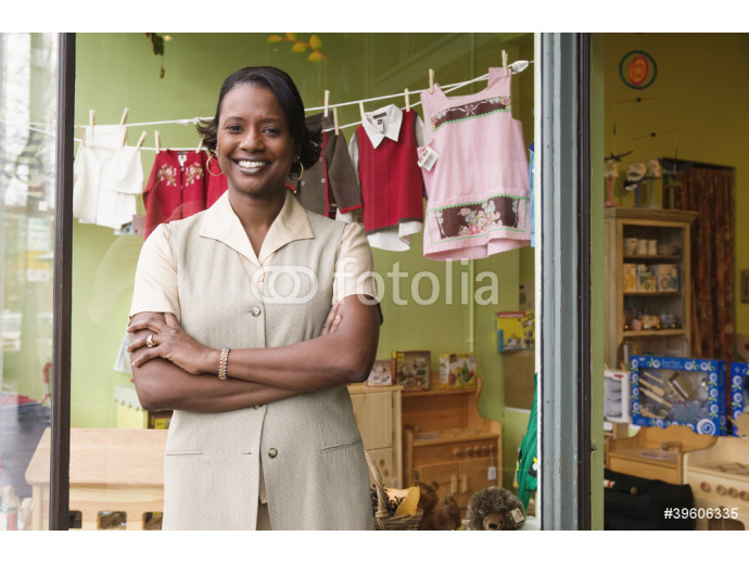 Portrait of woman in front of store window 64238