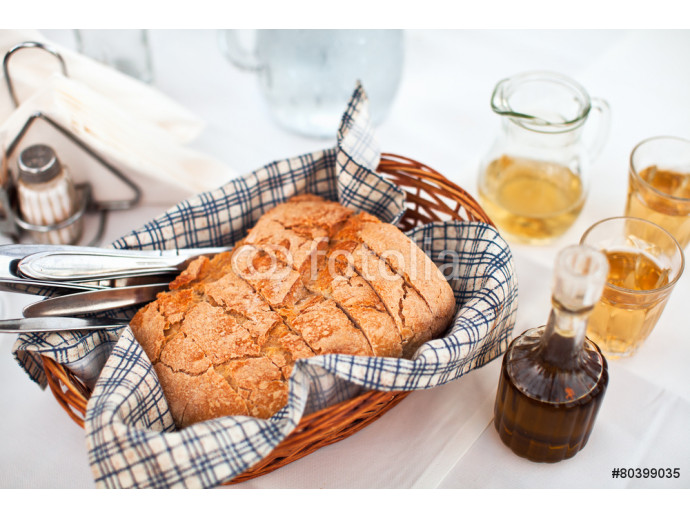 Fototapeta Homemade bread in greek taverna with olive oil and white wine 64238