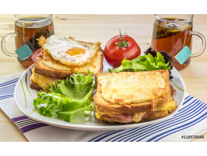 French breakfast for two people - Tasty breakfast for two persons with specific french food, croque madame (with egg) and croque monsieur, seasoned with fresh salad and tea. 64238