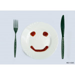 Smilie from ketchup on a white plate 64238