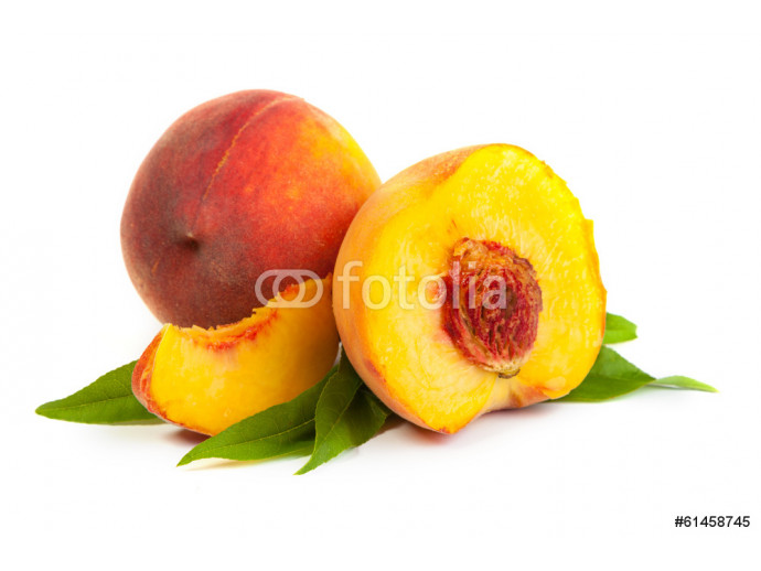 Three perfect, ripe peaches with a half  and slices isolated on 64238