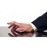 Business man's hand tapping fingers on a desk 64238