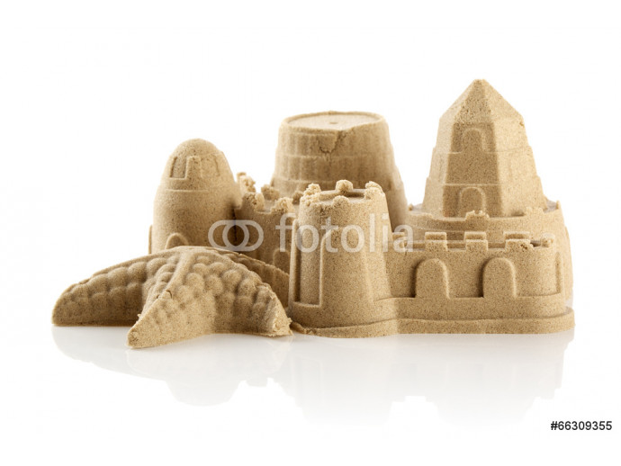 Sandcastle at the beach isolated over white 64238