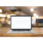 Laptop with blank screen on table. interior background, blurred 64238