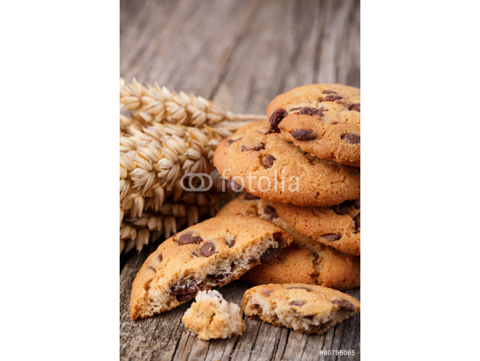 Tasty cookies with wheat on a wooden table. 64238