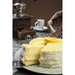 Vertical image of lemon cake with coffee mug at the background. 64238