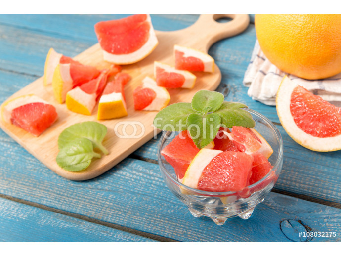 close up of fresh delicious oranges and grapefruit on an old wooden background 64238