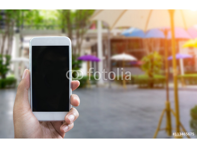 Man's hand shows mobile smartphone in vertical position 64238