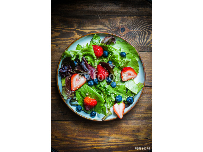 Green salad with berries on wooden background 64238