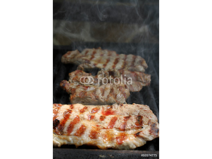 A top sirloin steak flame broiled on a barbecue, shallow depth o 64238