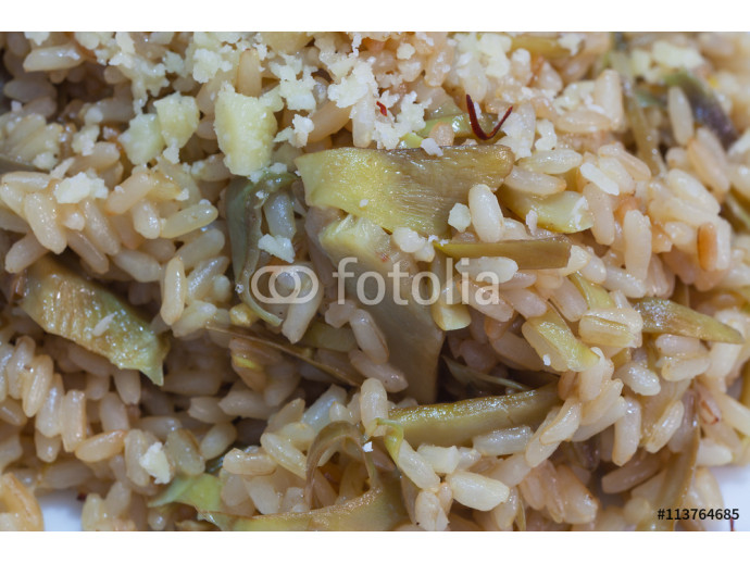 Brown rice with carciofi and cheese. 64238