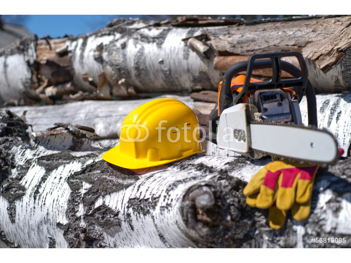 helmet and chainsaw on a background of wood texture 64238