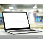 Laptop with blank screen on laminate table and blurred backgroun 64238