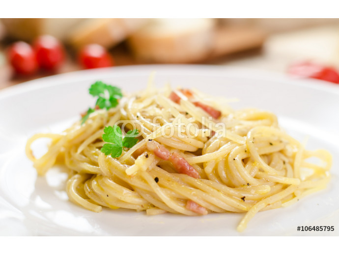 Pasta Carbonara with bacon on a white plate, close-up, side view 64238