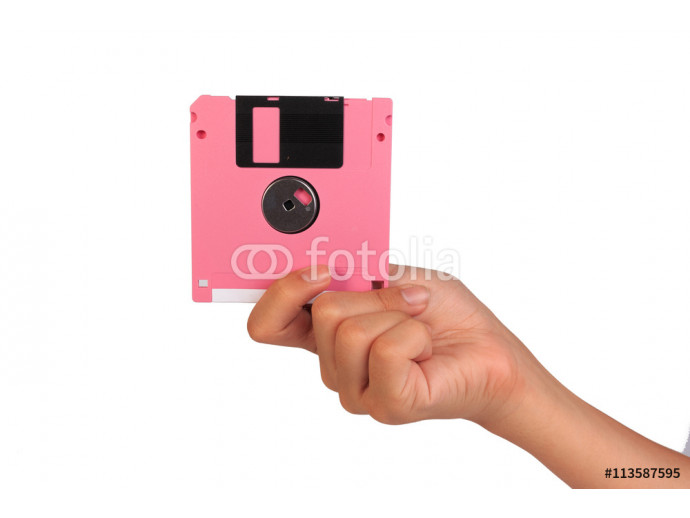 Holding floppy disc on white background. Computer floppy disk in hand. 64238