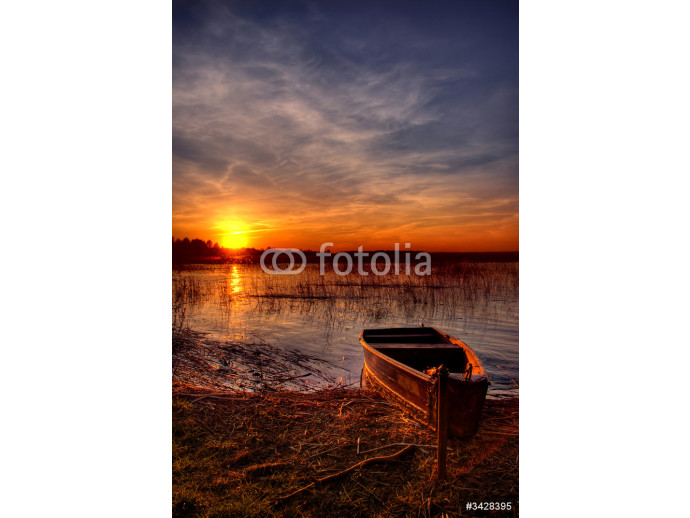 a boat by the lake at sunset 64238