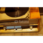 Old wooden radio with vinyl records 64238