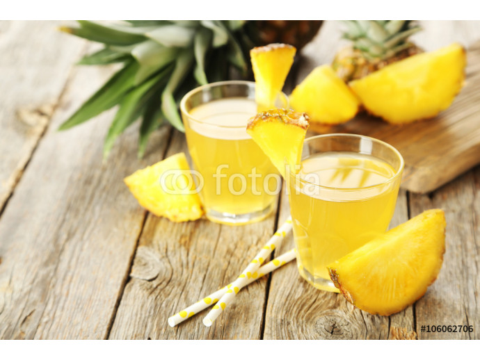 Glasses of pineapple juice on a grey wooden table 64238