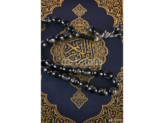 Close look for Quran and rosary 64238