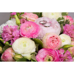 wedding rings on bouquet of white and pink peonies 64238