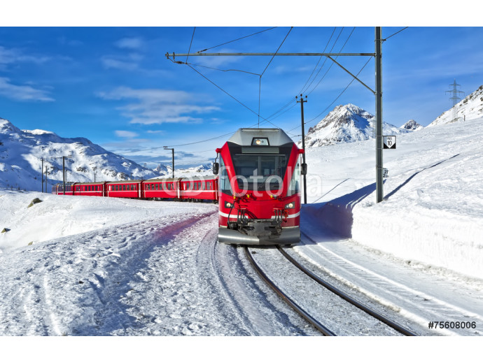 A red swiss train running through the snow 64238