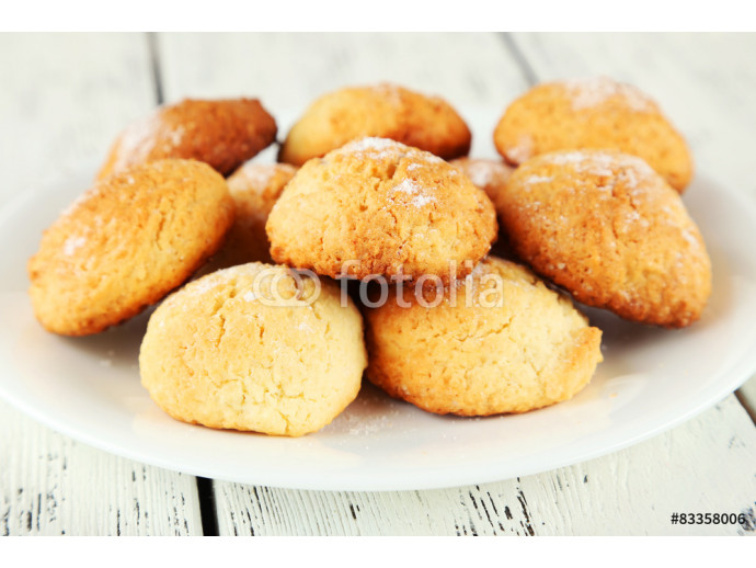 Coconut cookies on plate on white wooden background 64238