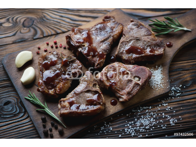 Grilled T-bone lamb steaks with sauce, garlic, rosemary and salt 64238