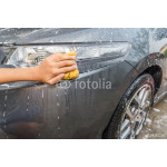 outdoor car wash with yellow sponge. 64238