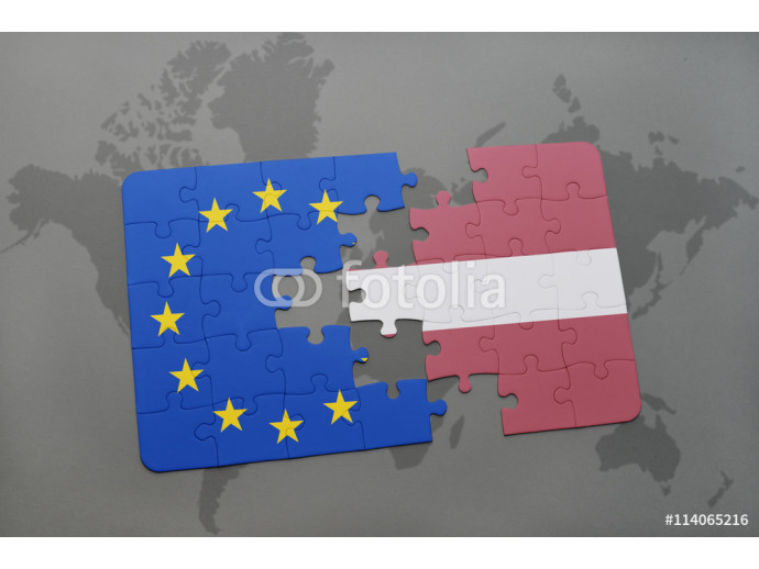 puzzle with the national flag of latvia and european union on a world map background. 64238