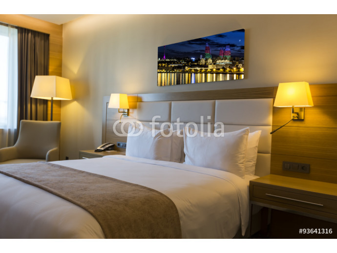 Beautiful hotel room with framed photo on the wall 64238