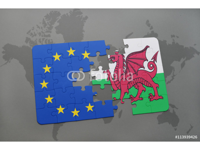 puzzle with the national flag of wales and european union on a world map background. 64238