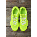 Pair of sport shoes on grey wooden background 64238
