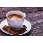 Coffee cup and beans on a wooden table. Dark background. 64238