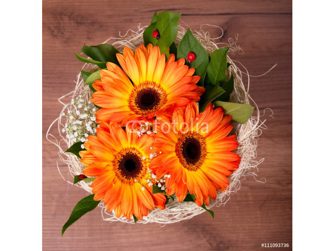 Bouquet of orange gerberas with small white blooms 64238