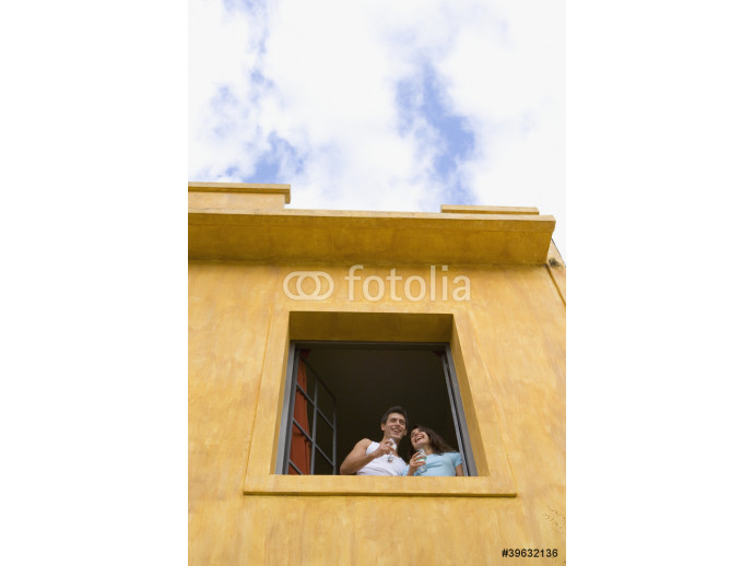 Couple with drinks looking out window 64238