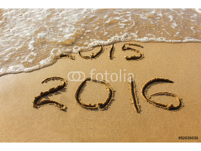 2015 and 2016 year written on sandy beach sea.  Wave washes away 2015. The concept of 2015 is gone, come the new year 2016. 64238