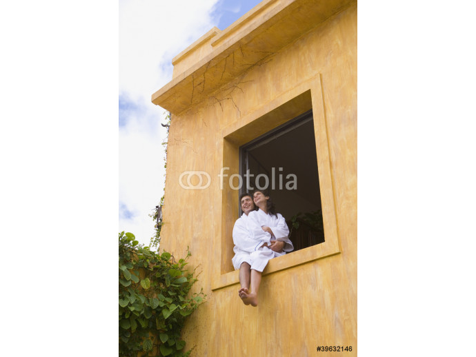 Couple in bathrobes sitting in window 64238